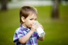 Little boy with glass of milk Royalty Free Stock Photo
