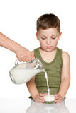 Little boy with a glass of milk Stock Images