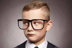 Funny child in suit and glasses Royalty Free Stock Image