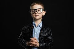 Little boy in glasses.funny child in trendy leather coat. Fashionable little boy in glasses.funny child in trendy leather coat Stock Images