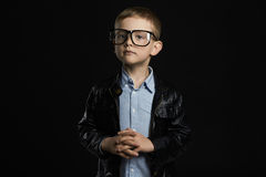 Little boy in glasses.funny child in trendy leather coat. Fashionable little boy in glasses.funny child in trendy leather coat Royalty Free Stock Photo