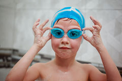 Little Boy in glasses and hat for swimming on bath. Royalty Free Stock Photos