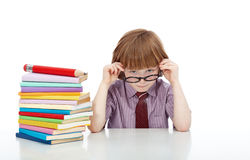 Little boy with glasses and lots of books Stock Photo