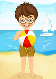 Little boy with glasses playing ball on tropical beach Stock Photo