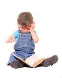 Little boy with glasses reading book Royalty Free Stock Photography