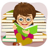 Little boy with glasses reading an interesting book Stock Image