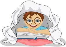 Little boy with glasses reads a book in bed under blanket Stock Images