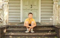 Little boy in glasses seat on doorstep Royalty Free Stock Photos