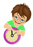 Little boy with glasses showing arrows on the wall clock Stock Image