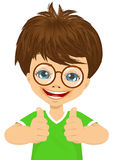 Little boy with glasses showing two thumbs up Royalty Free Stock Photo
