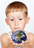 Little boy and Globe Royalty Free Stock Photos