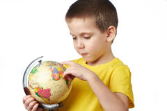 Little boy with globe Stock Image