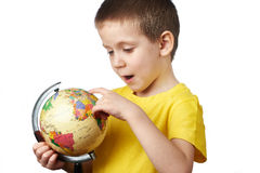 Little boy with globe Stock Photos