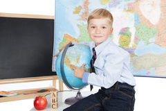 Little boy with a globe Royalty Free Stock Images