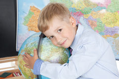 Little boy with a globe Royalty Free Stock Photography