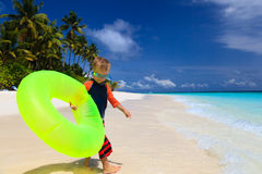 Little boy go swimming at tropical beach Royalty Free Stock Photo