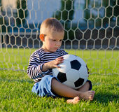Little boy in the goal with his soccer ball Royalty Free Stock Photos