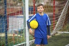 Little boy in goalkeeper uniform on football field. Sport. Royalty Free Stock Photos