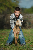 Little boy with goat on the farm Royalty Free Stock Photo