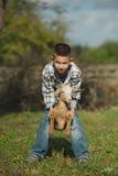 Little boy with goat on the farm Stock Photos