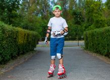 A little boy goes rollerblading in the summer stock images