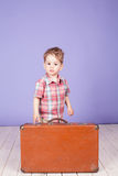 Little boy going on a journey with suitcase Royalty Free Stock Image