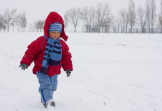 Little boy going on snow Stock Photo