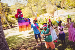 Little boy is going to broke a pinata for his birthday Stock Photo