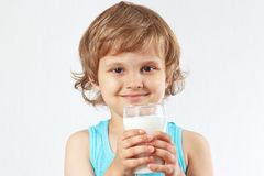 Little boy is going to drink fresh milk Stock Photos