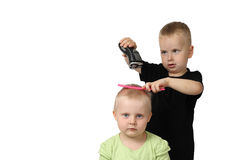 Little boy is going to shave hair of little girl royalty free stock image