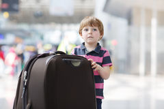 Little boy going on vacations trip with suitcase at airport Royalty Free Stock Images