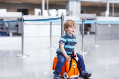 Little boy going on vacations trip with suitcase at airport Royalty Free Stock Photography