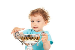 Little boy with a gold cup Stock Images