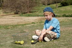 Little boy on a golf field Royalty Free Stock Photos