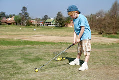 Little boy on a golf field Stock Photo