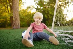 Little boy got injured playing football.Active outdoors game/sport for children.Safety concepts. Little boy got injured playing football.Active outdoors game/ royalty free stock photo