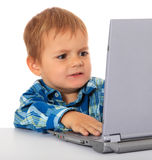 Little boy got a problem with his laptop. Cute little boy got a problem with his laptop. All on white background stock images