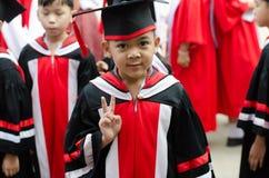 Little boy graduated from kindergarten school Stock Photography