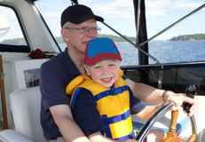 Little boy with grandather on a boat Royalty Free Stock Images