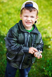 Little boy with gravel in hands Royalty Free Stock Image