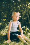Little boy in a gray T-shirt and shorts Royalty Free Stock Photo