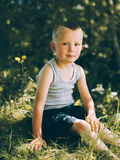 Little boy in a gray T-shirt and shorts Stock Photo