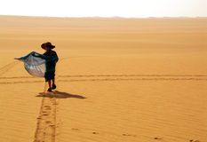 Little, boy and great desert Stock Photography