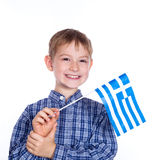 A little boy with greek flag. On the white background stock images
