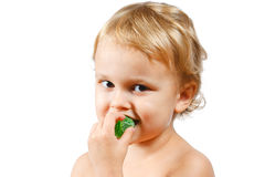 Little boy with green jelly candy Stock Photo