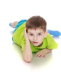 The little boy in the green shirt and blue shorts Royalty Free Stock Image