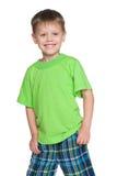 Little boy in the green shirt Stock Photos
