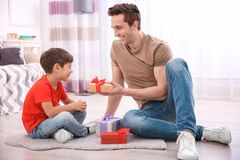 Little boy greeting   dad with Father`s Day. Little boy greeting his dad with Father`s Day Stock Images