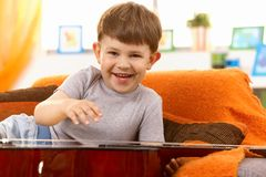 Little boy with guitar Stock Photography
