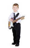 The little boy with a guitar in hands Stock Photo